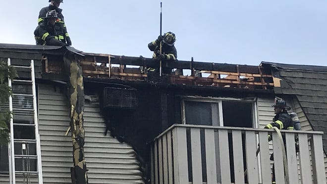 Marlborough firefighters work to extinquish a fire in one of the building in the Brook Village East Apartments in the city.
