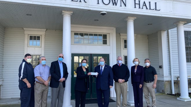 Select Board members Robert Belbin, Jim Hoffman, Mark Townsend and Sarah Hewins receive CARES Act reimbursement from Plymouth County Treasurer Tom O'Brien with Plymouth County Commissioner Greg Hanley, Rep. Susan Willams Gifford, R-Wareham, and Interim Town Administrator Rick LaFond outside Town Hall Oct. 23.