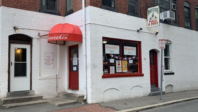 """Pinocchio's Pizza, a popular restaurant with students in Harvard Square, has been hit especially hard by the lack of students on campus this semester. """"Typically this time of year we're very busy with students, football games, and other events on campus, but obviously this year this isn't the case,"""" said owner Adam DiCenso."""