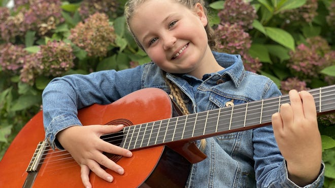 "Manomet Elementary School fifth-grader Alisa Higgins wrote and performed  ""I Miss Them,"" a song about the Covid-19 pandemic."