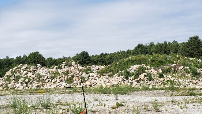 A picture of boulders left from a previous project. Manny Soares is not allowed to work on site. He is looking to sell the property, which is tied up in legal issues.