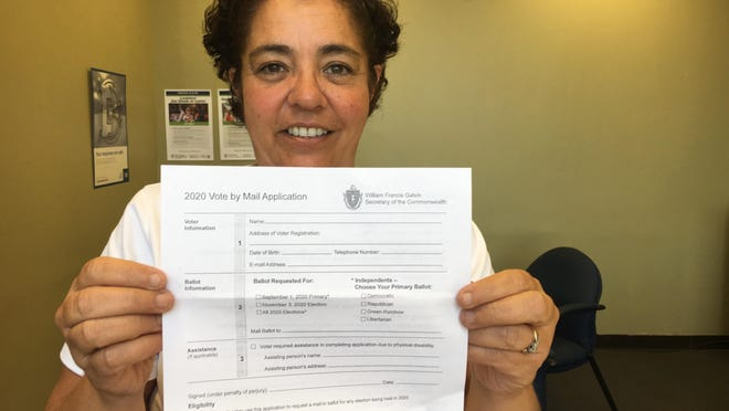 Board of Elections Chairwoman Kelly Souza-Young, seen in this file photo from April, said the state anticipates mail-in ballots for the November election will be available by Oct. 9.