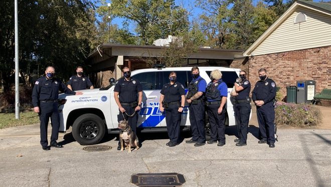Eight members of the Fort Smith Police Department, and Pawfficer Fuzz, participated in the walk to support suicide prevention.