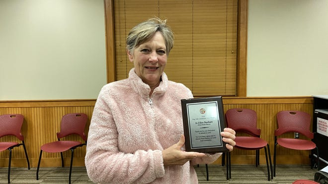 Jo Ellen Bonhart, president of Almost Home Shelter in Van Buren, has been given a Community Hero award from Dog Talk in Little Rock. Along with the plaque, a $500 donation was given to the shelter.
