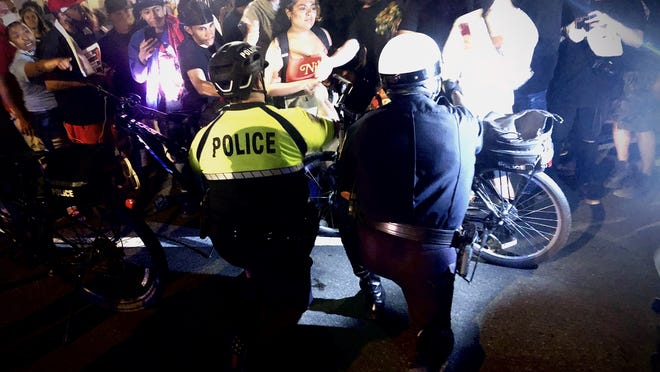 A rowdy and sometimes impassioned crowd finally left late Thursday night after two police officers took a knee at Taunton Green following a protest rally on Church Green.  Taunton Gazette photo by Charles Winokoor