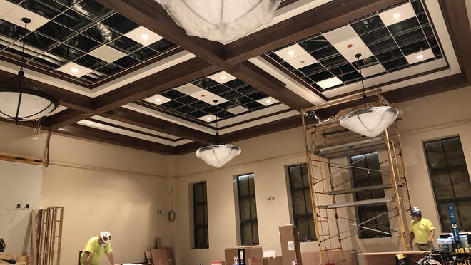 The interior of the new Chester R. Martin Municipal Council Chambers at the renovated Taunton City Hall features what's known as a coffered ceiling.  Taunton Gazette photo by Charles Winokoor