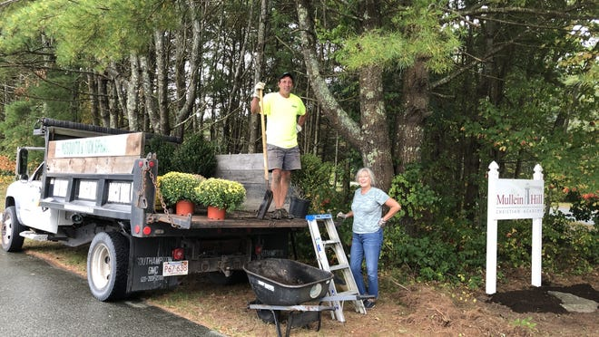 Parents and friends of Mullein Hill Christian Academy, 25 Staples Shore Road, worked hard at the academy to perform landscaping renovations.