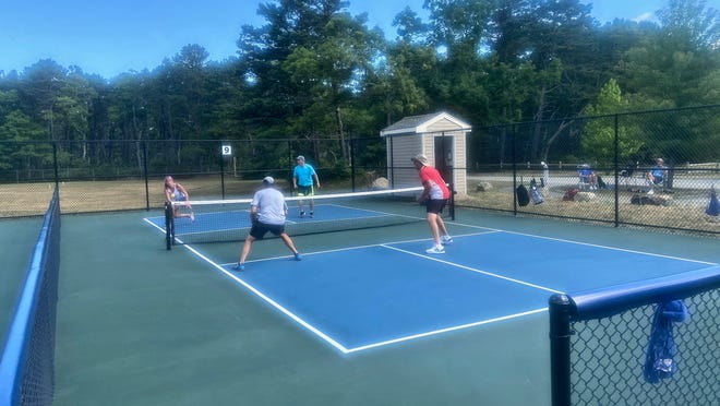 Taryn Zuccala and Joe Bourassa take on Jim Houghtaling and Tom Donahue in pickleball at Flax Pond Recreation Area in Yarmouth.