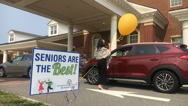 Director of Elder Affairs Michelle Bratti welcomes seniors to Senior Appreciation Day at the start of Tuesday's parade for local senior citizens.