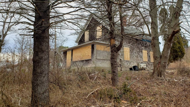 In the spring, the New Bedford-based Tree Beard Inc. met with selectmen and proposed turning an abandoned home at 1104 Main Road, seen here into a marijuana facility. Tree Beard is also looking at sites at 678 Main Road, 983 State Road and 0 Wildberry Way.