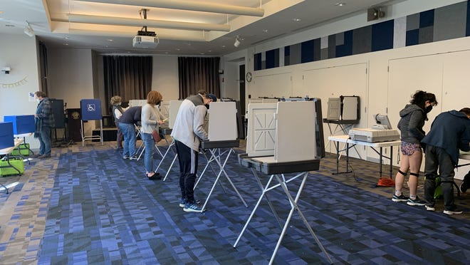 Residents cast their ballots at the Newton Free Library polling location Saturday, Oct. 17, at the start of early voting for the Nov. 3 election.