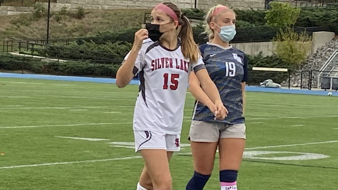 Plymouth North's Caileigh Koylion (right) keeps a close eye on Silver Lake's Shea Kelleher in action from earlier this season. Both schools are hoping to make a run in the upcoming Patriot Cup tournament.