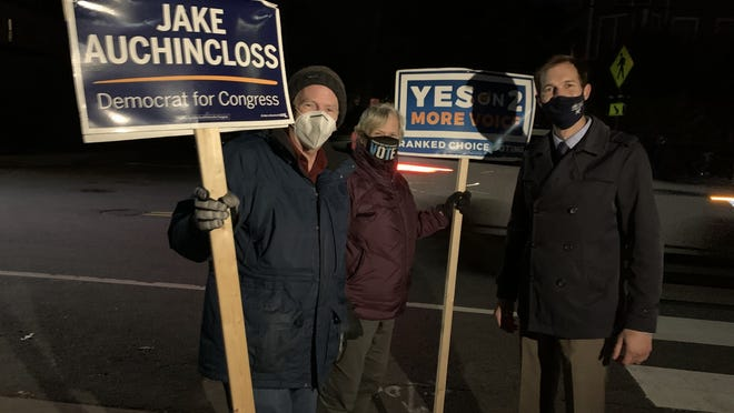 Newton City Councilor-at-Large Jake Auchincloss pulls down his mask to kiss his wife Michelle after winning the MA04 congressional district seat on Nov. 3. He made the announcement on Gould Street in Needham.