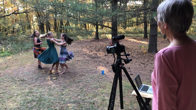 During production of the third Rusty Pickup Barn Dance video in rural Chillicothe Oct. 4, Gail Heinz calls the steps while sisters Lucy Poeppel, 18, Susannah Poeppel, 16, and Laura Poeppel, 12, dance.