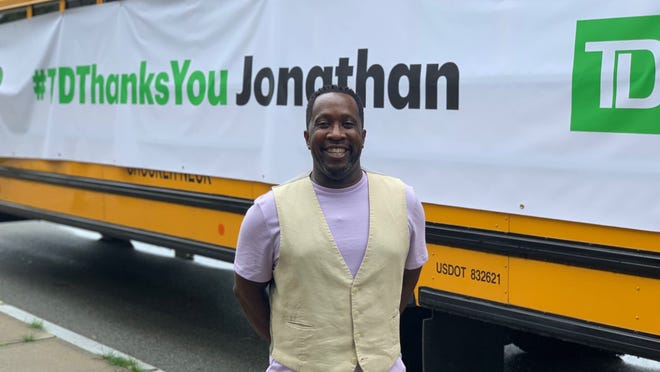 TD Bank surprises Jonathan Thompson, host of JT's Chronicles, with a bus load of backpacks and back-to-school supplies last Thursday.