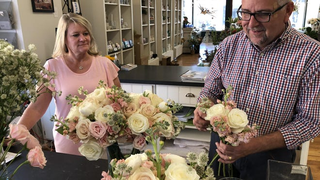 Arranging flowers on Friday for a Saturday wedding, Sandy and Norman Keller, owners of Regeena's Flowers & Events, 1013 Main, talked about being one of the hosts for the Sept. 25 Dining with Downtown tables.