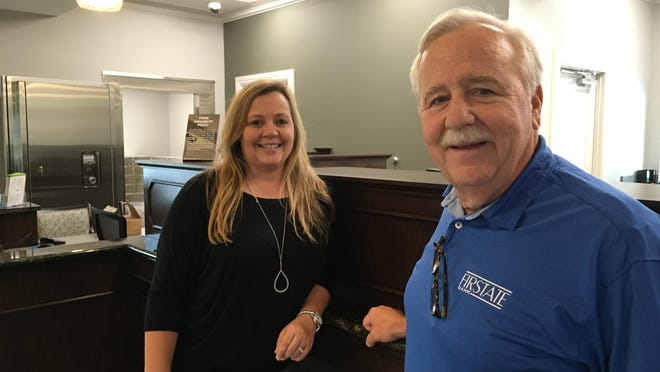 First State Bank branch manager Hope Hodge and CEO Lee Clark stand by the teller line of the new Harlem, Ga., branch office set to open on Monday.