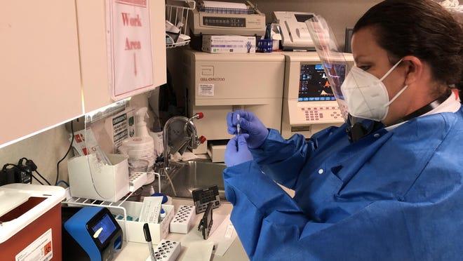 Lab technician Myra Powers runs a coronavirus test at Medical Specialists Inc. in Waynesboro on Wednesday July 29, 2020.