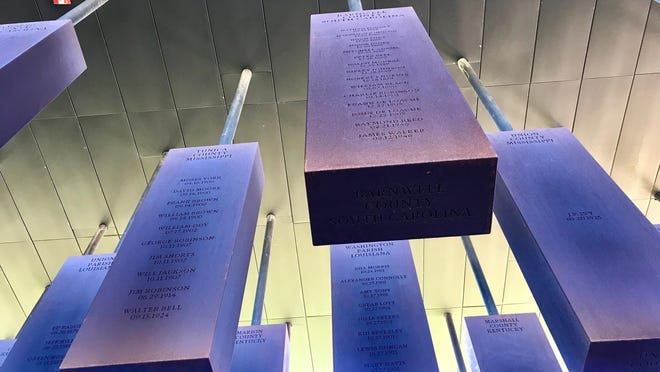 Steel slabs bearing the names of lynching victims killed between the Civil War and 1949 hang at the National Memorial for Peace and Justice in Montgomery, Alabama.