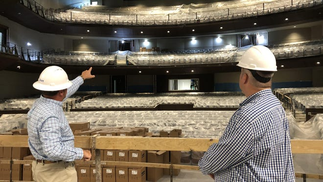 Columbia County Administrator Scott Johnson (left) and Performing Arts Center General Manager Matt Jameson look from center stage at the center's first- and second-level balconies.