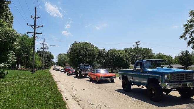Some of the 60 hot rods, antique cars and other vehicles roll into Cedarville Saturday bringing food donations as part of the Cedarville Lions Club's car cruise to benefit the Salvation Army in Freeport.