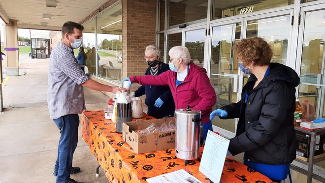 Women from Freeport Recycle Store serve up coffee, apple cider and donuts Saturday, Oct. 3, 2020, at Lincoln Mall in Freeport as part of Customer Appreciation Day. Weather canceled the car Cruise-In, but plenty of pumpkins were available for kids to decorate for the fall season.