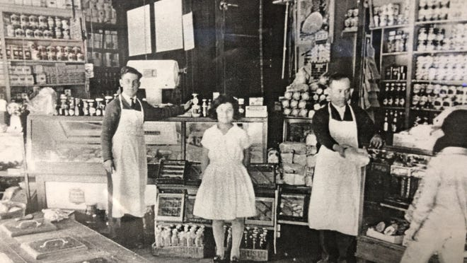 This photo from 1925 show the interior of Haddad's second location at 701 First St. in Peoria. Shown are Fred Haddad, left, Frieda Haddad, middle, and Joseph Haddad.