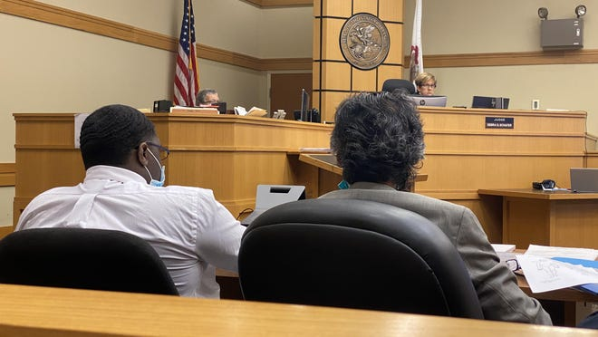 Raheem King, left, sits alongside his attorney, Kunal Kulkarni, on Friday on the final day of his trial over the fatal shooting of three men in April 2018.