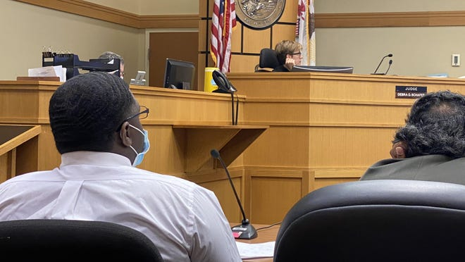 Raheem King, left, sits in the courtroom with his attorney, Kunal Kulkarni on Thursday, Aug. 20, 2020. King is charged with fatally shooting three men aboard a party bus in April 2018.