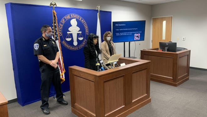 Rockford Police Department Chief Dan O'Shea, from left, Winnebago County State's Attorney Marilyn Hite Ross and Deptuty State's Attorney Brenda Quade discuss a rise in gun violence at a news conference on Friday in Rockford.