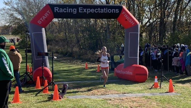 Winnebago senior Natalia Martino cruises through the finish line with a commanding victory in Saturday's Class 1A Seneca Sectional in Marsailles. Martino finished first, and the Winnebago girls won the sectional team title.