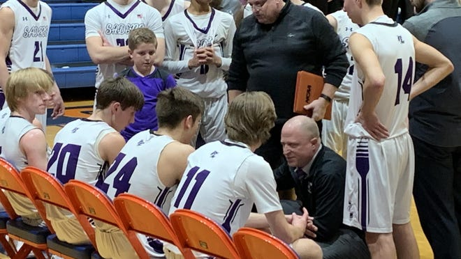 Lutheran head coach Tom Guse, kneeling, talks to his team in the second half of the Crusaders' Class 2A sectional semifinal win against Northridge Prep on March 4 at Genoa-Kingston High School in Genoa.