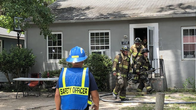 Savannah firefighters respond to a house fire on May 29, after safety protocols were established to protect Savannah Fire staff from COVID-19.