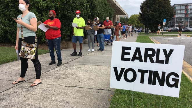 The voting line stretched across the eastern facade of the Civic Center on Monday morning as early voting started.