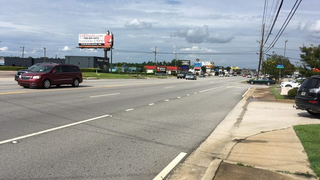 """A photo of Washington Road near the Bobby Jones Expressway intersection shows midday traffic in the Martinez commercial corridor. The major gateway to Columbia County is poised to be the first """"tax allocation district,"""" or TAD."""