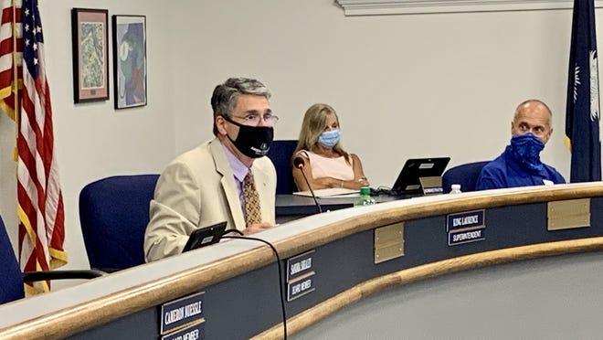 Aiken County Superintendent King Laurence, left, recommending that their reopening plan remains unchanged with the two different education models for families to choose from during the board's special called meeting Tuesday, July 21.