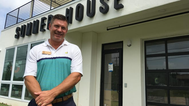 James Schaffer, owner and broker at Summer House Realty, stands in front of the company's new Augusta office under construction on the 2700 block of Washington Road.
