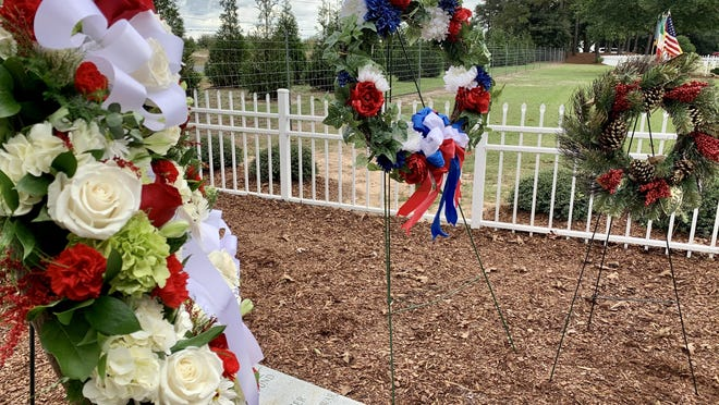 Wreaths are placed at the graves of German World War II prisoners buried at Fort Gordon during a German-Italian Memorial Ceremony Sunday, Nov. 15.