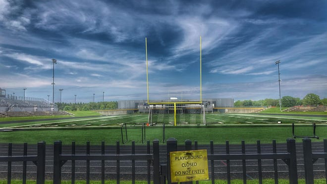 The gates at Galesburg HIgh School's Van Dyke Field will remain secured tight with chains and padlocks until Monday.