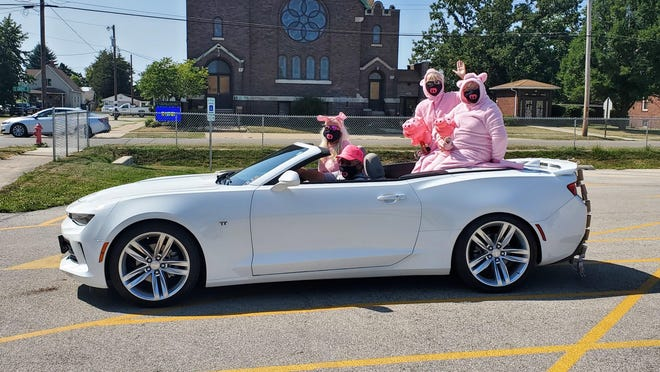 The Hog Days parade consisted of one convertible, driven by Rick Matuszyk, with passengers, Sherri Matuszyk, Pat Keim and Mary Nosalik all dressed up in full pig regalia. The one entry began at the Kewanee High School parking lot at 2 p.m. and drove the entire parade route.