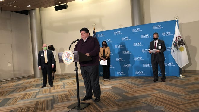 Gov. JB Pritzker speaks Monday afternoon, Oct. 26, 2020, about COVID-19 at Jump Trading Simulation and Education Center on the campus of OSF HealthCare in Peoria.