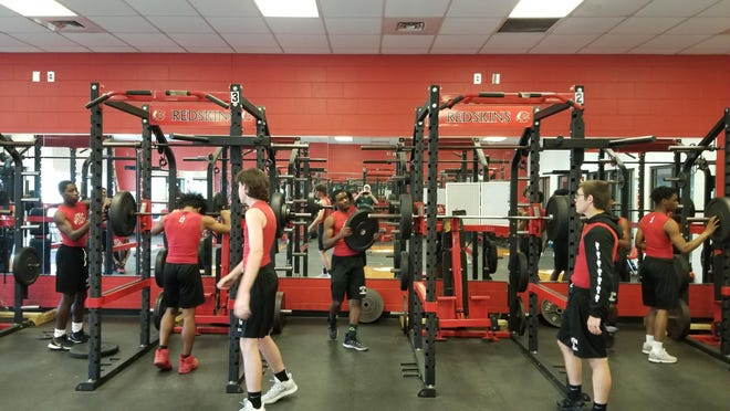 Bryan County High School football players work out in the weight room in Pembroke.