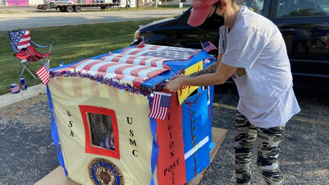 Jennifer Lawson, a longtime employee of American Legion Post 32 and the mother of a Marine currently stationed in Okinawa, Japan, puts the finishing touches on her box during the third annual Camp Out for Homeless Veterans fundraiser for Fifth Street Renaissance.