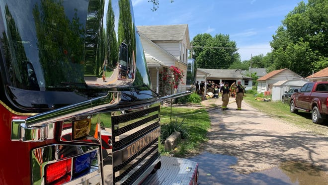 Topeka Fire Department crews responded to a garage fire.