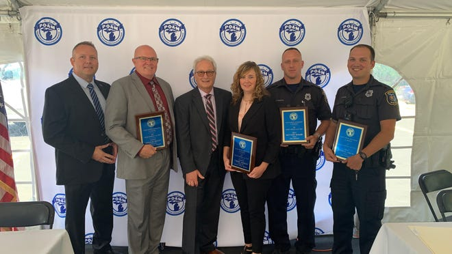 Monroe Police Chief Charles McCormick IV (from left) stands with Cpl. Donald Brady, Police Officers Association of Michigan (POAM) President Jim Tignanelli, Lt. Terese Herrick and Officers Joshua Sawdy and Matthew Reaume when the officers were named among POAM's 2020 Police Officers of the Year.