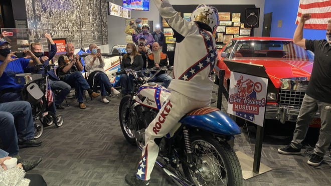 "Louis ""Rocket"" Re raises his arm in the air Saturday after riding Evel Knievel's long lost 1968 American Eagle Laverda jump bike inside the Evel Knievel Museum."