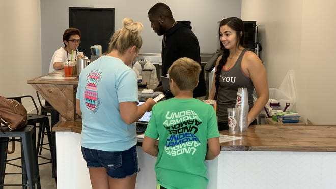 Owners Desiree Maw and Brandon Newton serve up shakes and smiles to customers at their new business, The Daily Spot.
