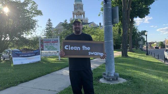 """Jeff Girdham held a solo protest Saturday on the lawn of the Hillsdale County Courthouse to protest """"local corruption"""" in the police and court systems."""