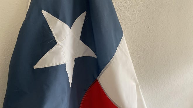 This Texas flag, which once flew over the state Capitol, is among the souvenirs that Statesman political editor and columnist Jonathan Tilove has acquired over the past eight years.