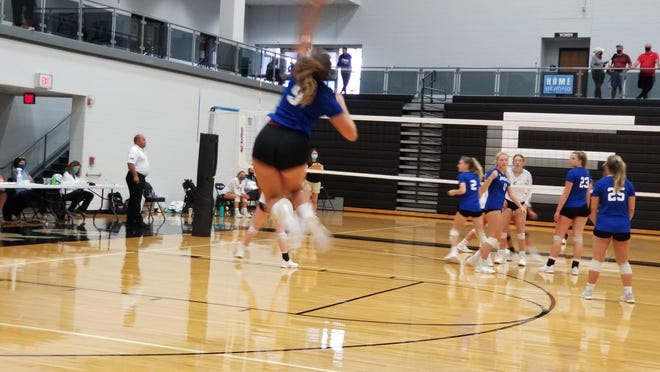 Andover junior MayaMay Brown sends the ball over the net against Goddard Eisenhower on Saturday, August 29 in the AVCTL Preseason Tournament. The Trojans went 3-1 on the day